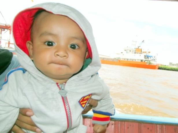 My Son, Abizar's on the Board -- Barito River --